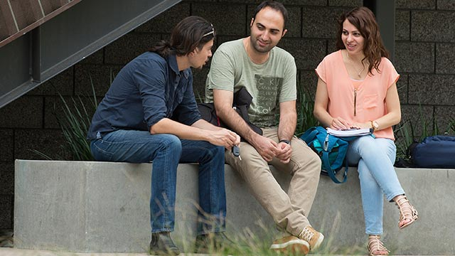 Students in the College of Business Courtyard.