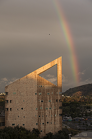 A rainbow frames the CLA building after a day of heavy rain at Cal Poly Pomona.