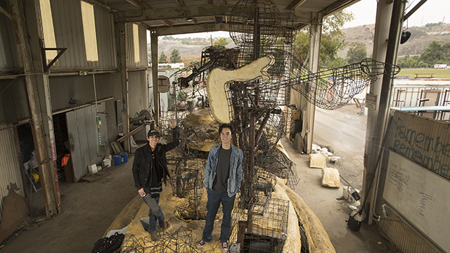 Christopher Maciosek and Naythan Muro with the Cal Poly Universities Rose float, Far Out Frequencies.