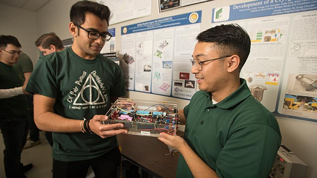 Engineering students Alden Caterio and Deep Patel work on a project they hope will best the world record for the longest flight by an electric powered unmanned aerial vehicle.