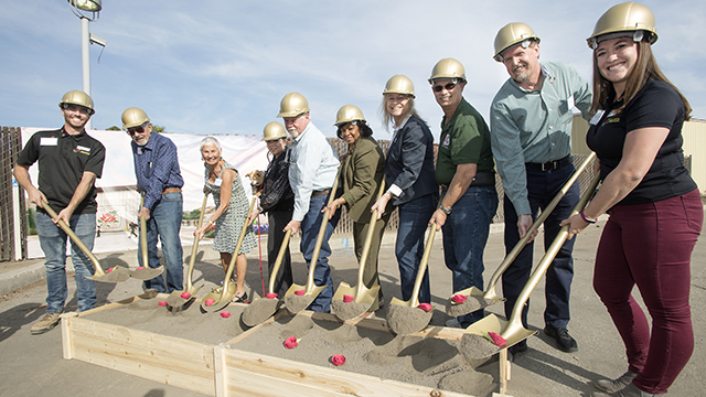 President Soraya Coley and others take part in groundbreaking ceremonies for the Rose Float Lab at Cal Poly Pomona November 17, 2018.