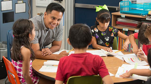 Former credential student Eric Guzman works with students at Collegewood Elementary School in Walnut.