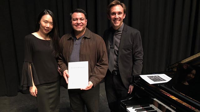 Yafei Lin (left) and Vernon Snyder (right) recently debuted a composition written by Kevin J. Garnica, a piano accompanist in the music department.