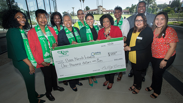 President Soraya Coley accepts donation to the Basic Needs Initiative from Links Incorporated.