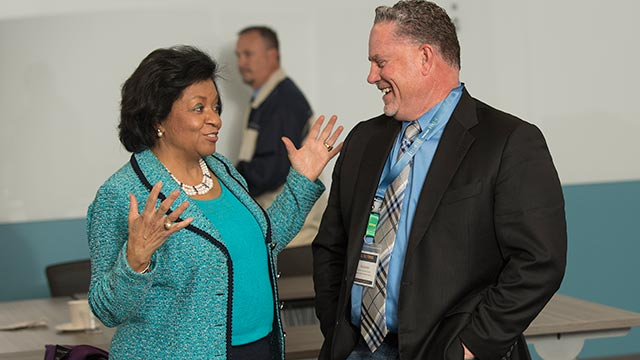 University President Soraya M. Coley chats with Rod Zerbel, director of personnel services for the Covina Valley Unified School District, during a summit with school districts administrators and principals.