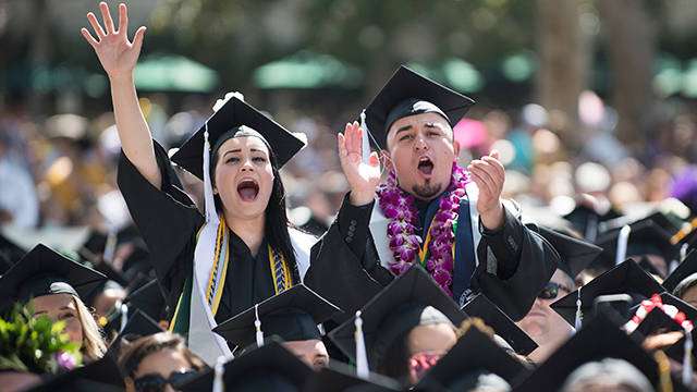 Graduates cheer at the College of Letters, Arts and Social Sciences commencement ceremony.