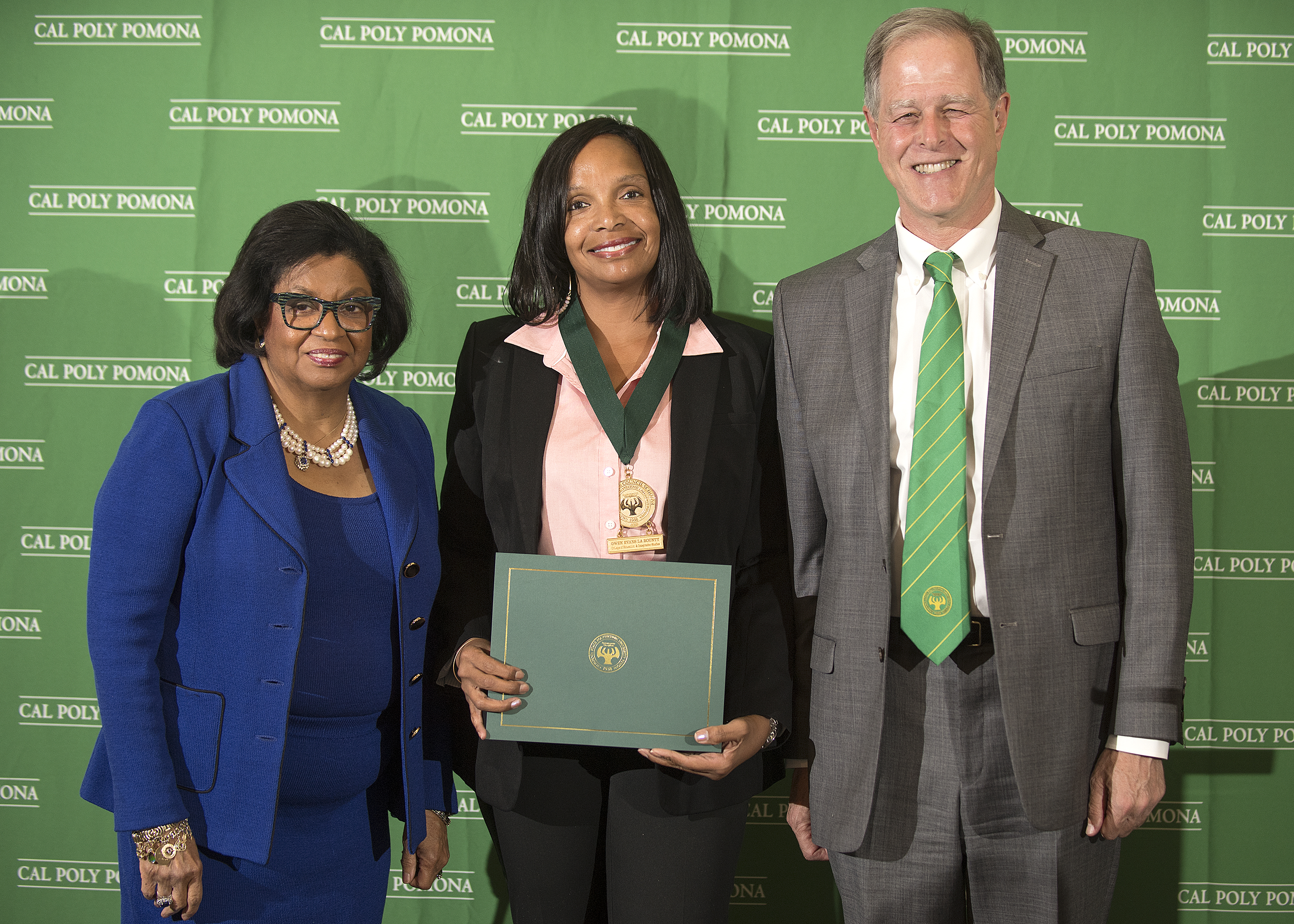 Education doctoral student Marybeth Murray, pictured with University President Soraya M. Coley and CEIS Dean Jeff Passe, was named a Presidential Scholar.