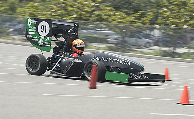 Aaron Aguirre drives the Cal Poly Pomona Formula SAE car during testing in the overflow parking lot in preparation for a competition in Lincoln Nebraska later this month.