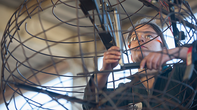 Cindy Dice, a Engineering Major, works on the mechanicals of one of the aliens on the 2019 Cal Poly Universities Rose Float, Far Out Frequencies.