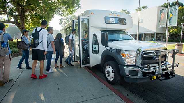 Students lined up to take the Bronco Shuttle