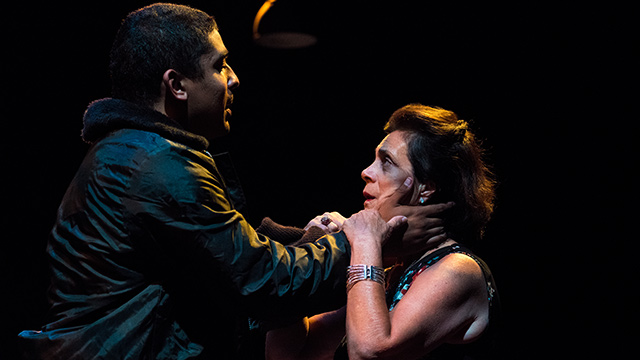 "Linda Bisesti (right) portrays the Gothic queen Tamora embracing Aaron (Kris Dowling) in the Southern California Shakespeare Festival's production of ""Titus Andronicus."""