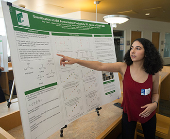 Student explains her research on ABE Fermentation Products.