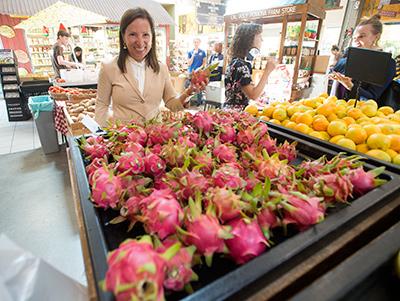 Kounalakis admires the dragon fruit at the Farm Store.