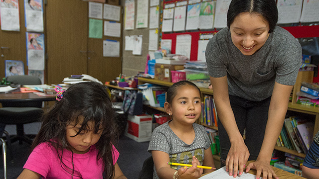 Melody Banuelos, a Prete Fellow, works with youngsters at Armstrong Elementary School.