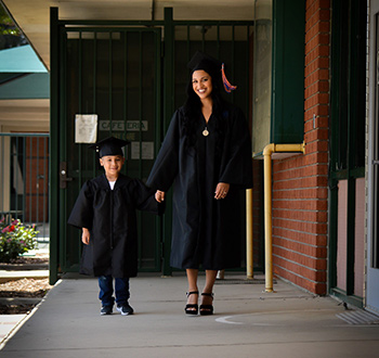 Amy walks with her son, who graduated from Kindergarten.
