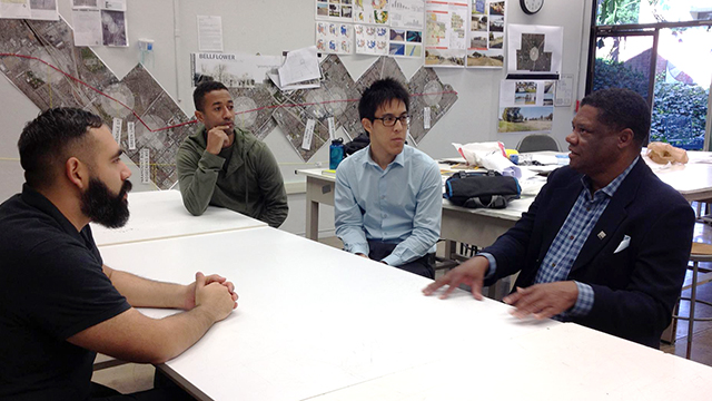 Urban and regional planning students meet with alumnus Earl Gales Jr. ('72, urban and regional planning), the chair and CEO of Jenkins/Gales & Martinez, an architectural, program and construction management firm.