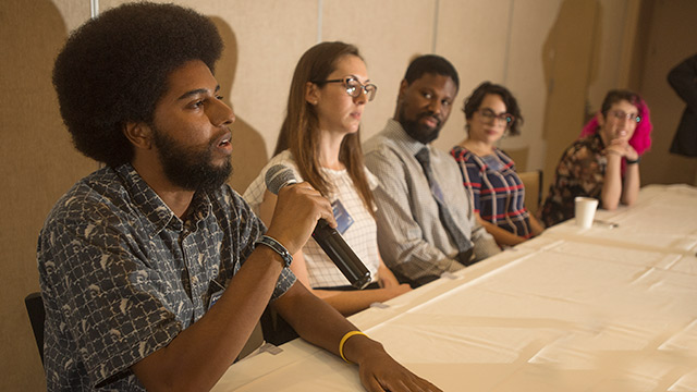 Cal-bridge program students speaking at a symposium
