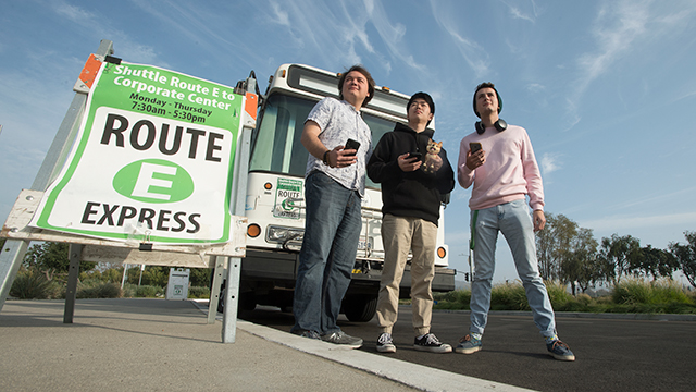 IT students pose by Bronco Shuttle