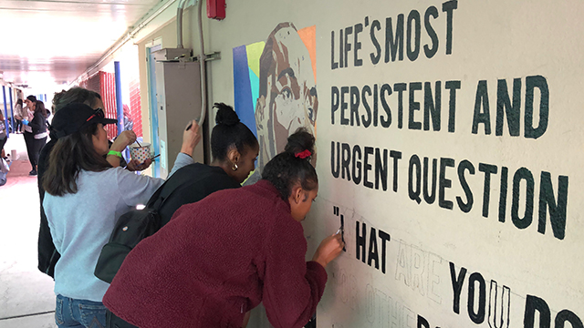 Students paint a mural