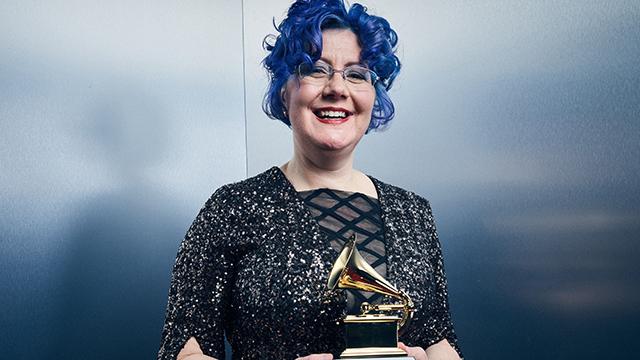 Nadia Shpachenko holding her Grammy.