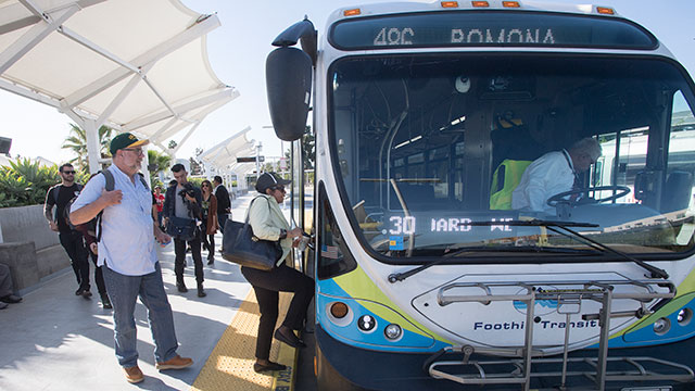 President Coley enters a Foothill Transit Bus