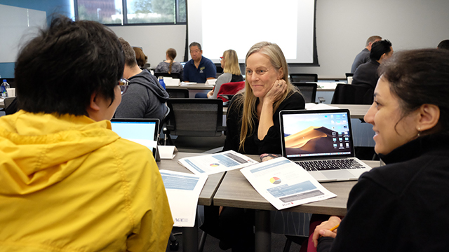 CPP faculty members converse during their ACUE course about effective teaching practices.