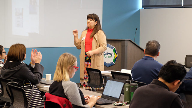 Kim Middleton leads orientation for 31 CPP faculty members joining the Association of Colleges and University Educators program.