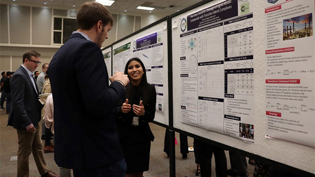 Student presenting her poster at the 8th Annual RSCA conference.