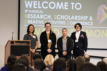 group picture of one of the winning teams from the competitive oral presentations.