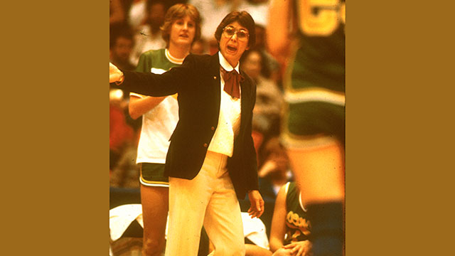 Darlene May coaches during a games