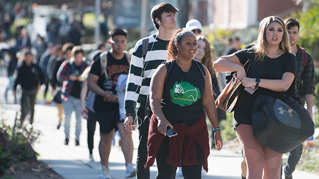 Students walk on campus on the first day of the Fall semester.