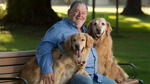 Aubrey Fine with two golden retreivers