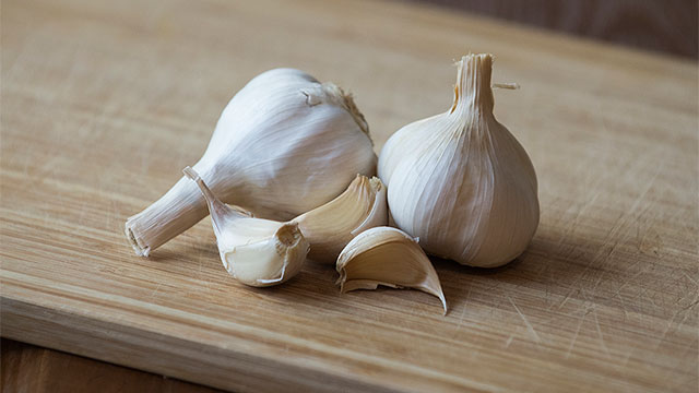 three cloves of garlic on a table