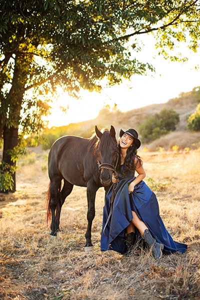 Lauren poses with a horse.