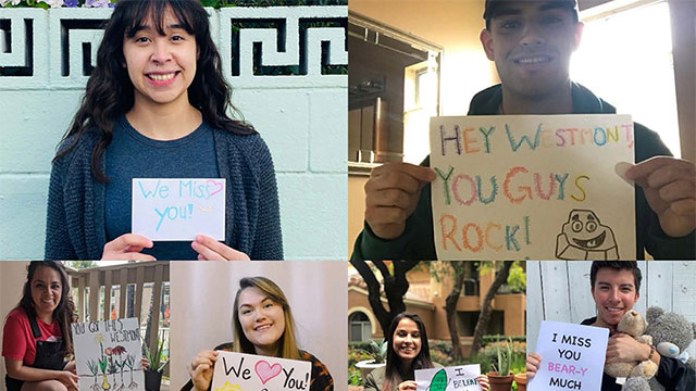 Science Prete Fellows hold up signs of support