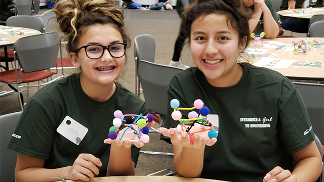 Two young girls participate in Introduce a girl to Engineering.