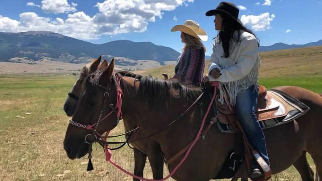 Lauren Ruiz and her mom riding horses.