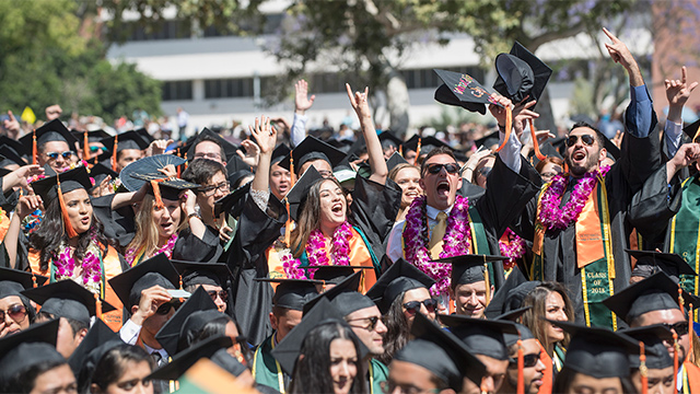 Students celebrating during the College of Engineering 2018 graduation.