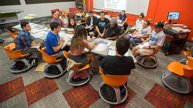 Students study and participate in a group session pre COVID-19.