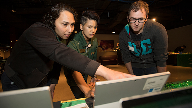 Elke Azpeitia (left) and Chan (center) help a student veteran complete his acceptance to Cal Poly Pomona during an Everyday is Veterans Day event in 2018.