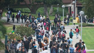 Students walk across campus.