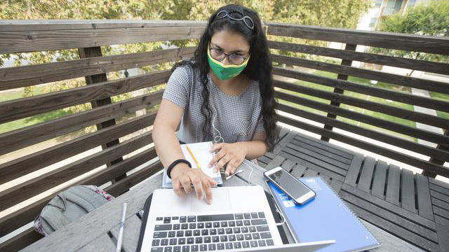 Neelam Mistry working on her laptop
