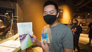 Caleb Ng picks up his Class Pass bus pass at the Games Room