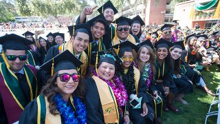 Group of grads smile during the 2018 College of Science Commencement Ceremony.
