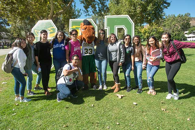 A group of transfer students pose with Billy Bronco.