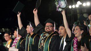 Graduates celebrating during Commencement